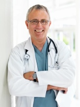 Smiling senior doctor with stethoscope